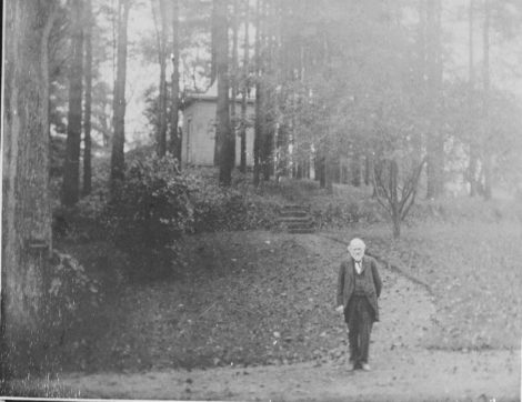 Charles J. Taylor (1824-1904), author of the 1879 'History of Great Barrington,' at the foot of the path leading to his writing cabin. He lived in the South Street house that is now occupied by Finnerty & Stevens Funeral Home. Photo courtesy of the Great Barrington Historical Society.