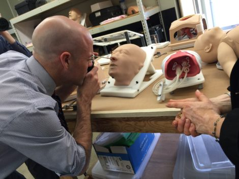 Adam Hinds examines the sinus cavity of a model head.