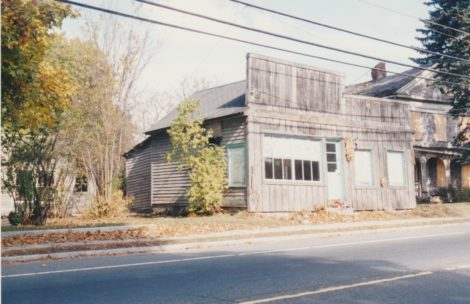 Small retail shops on the north side of Main Street east of the Brown Bridge included this one, which was razed in 1998. (Bernard A. Drew photo 1998)