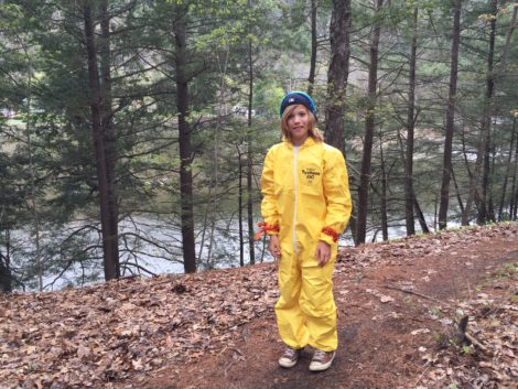 Landon Curletti, 11, who lives down the street from the dump, dressed in a Haz-Mat suit. Photo: Heather Bellow