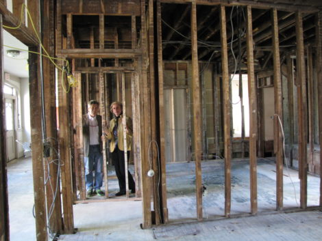 The Harrises, in the maze of studs during the early early renovation of St. James Place.