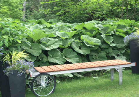 This bench by Berkshire Woodworkers Guild member Mike King can easily be moved to view different parts of the garden (and for mowing the lawn easily.) Photo: Lee Buttala