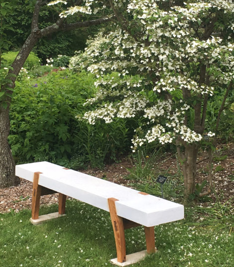 A bench with no back can allow one to sit an face multiple perspectives in the garden. The stone and wood bench by West Stockbridge craftsman Peter Thorne uses such stones more often used for civil war gravestones. At one point it could be found throughout the area. Photo: Lee Buttala