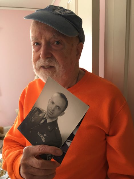 Don Victor with a photograph of himself when he was in the Air Force.