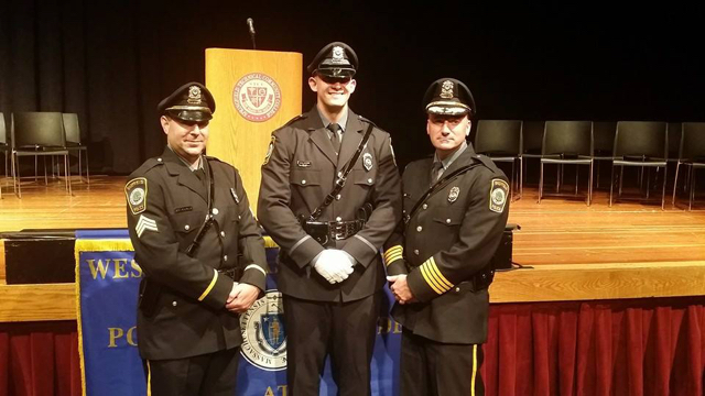 At a Sheffield Police Department awards ceremony in 2014, from left: Sergeant Ryan Kryziak, Officer Brennan Polidoro, and Chief Eric Munson III.