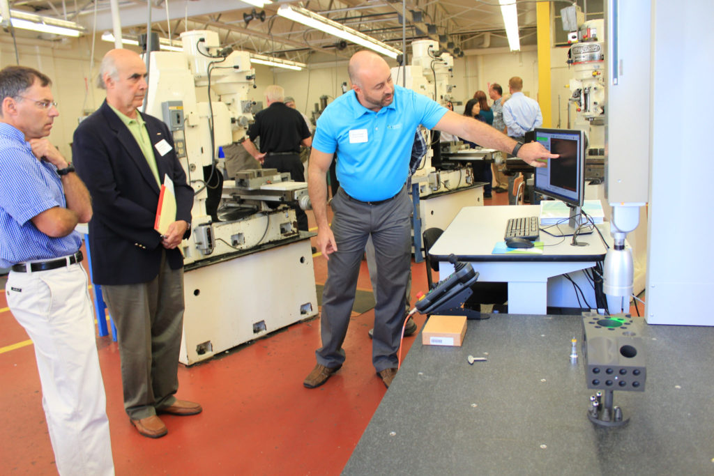 Shawn Grady of Hexagon Metrology demonstrates the Hexagon Global Performance Silver Edition Coordinate Measurement Machine at a Berkshire Innovation Center event on Thursday, Sept. 15. The machine features technology essential in quality control in the medical device and aircraft industries.