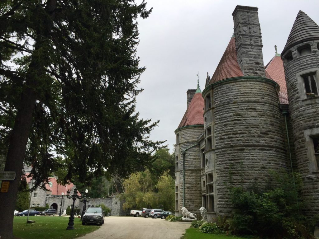 Searles Castle, foreground, and carriage house, left. The property near the Castle is also considered historic. Photo: Heather Bellow.
