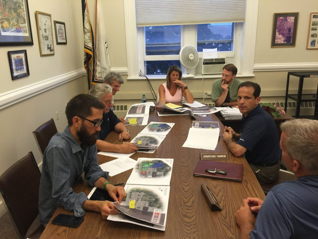 At the Planning Board meeting last month: Benchmark Development's Brian Cohan and Michael Charles (at right) talk about the company's plans for a new, mixed-use development on Bridge Street. From left: Planning Board members Jeremy Higa, Jonathan Hankin and Malcolm Fick; secretary Kim Shaw; and Town Planner Chris Rembold. Photo: Heather Bellow.