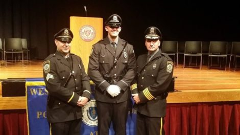 At an awards ceremony in 2014, from left: Sergeant Ryan Kryziak, Officer Brennan Polidoro, and Chief Eric Munson III.