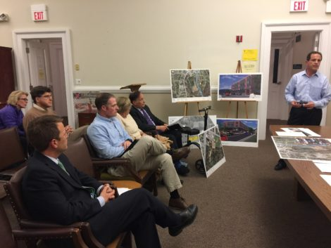 Benchmark Develpment's Michael Charles, standing, speaks to the Historic District Commission about how he will screen Searles Castle from a new development off Bridge Street. Seated, front row from left: Benchmark attorney Nicholas Arienti, John Dewey Academy Facilities Manager Robert Gaughran, Searles owner Carole Bratter. St. James Place developer Sally Harris, left, and Berkshire Co-op Market board president Dan Seitz, in second row. Photo: Heather Bellow