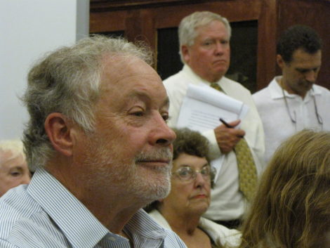 Nick Kelley, foreground, at Selectboard hearing. Standing behind him is his attorney, Edward McCormick.