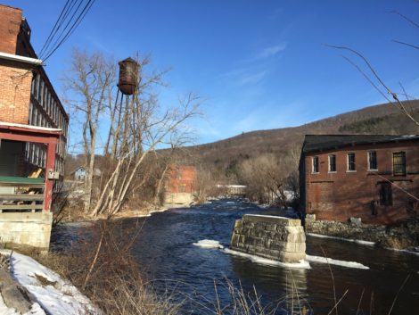 Mill buildings flank the river and the remains of a bridge abutment is a testament to a time when there was thriving commerce along the river. Photo: Heather Bellow