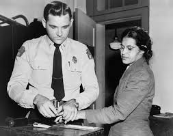 Rosa Parks being fingerprinted after being arrested for refusing to give her seat on a city bus to a white person.