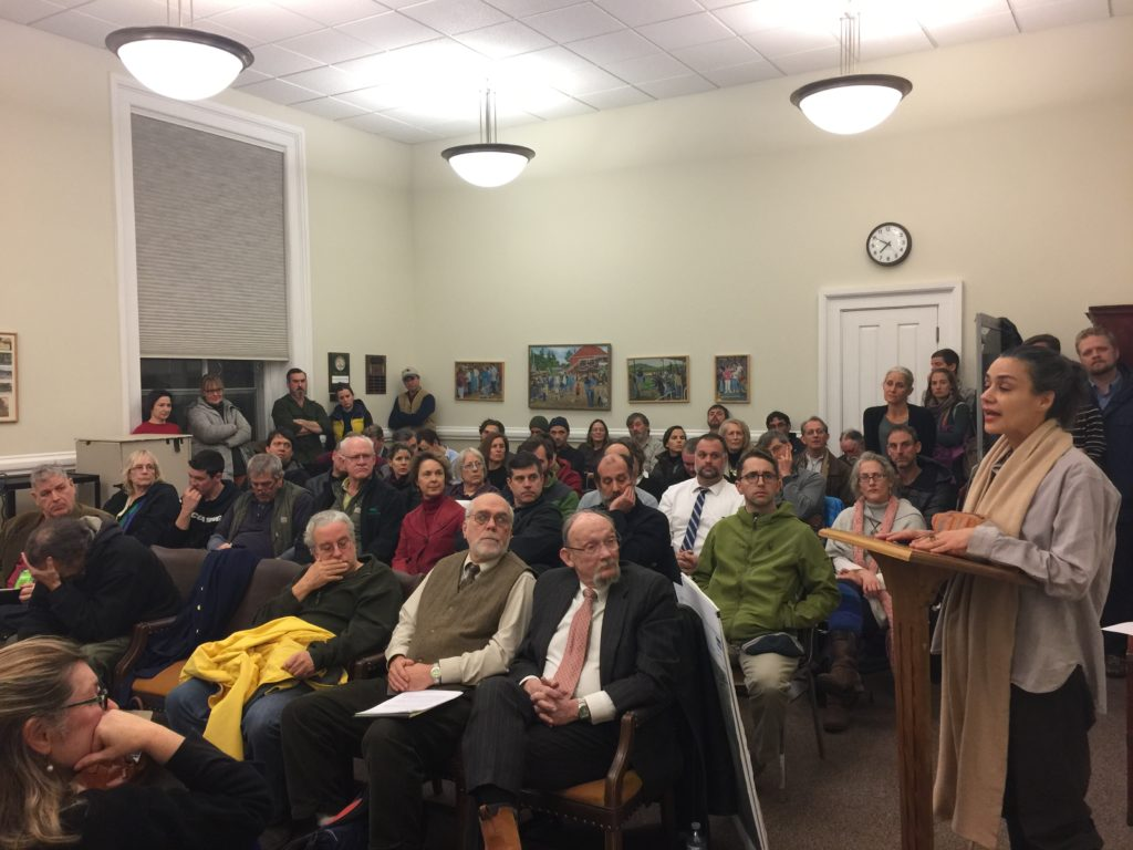 A packed Zoning Board of Appeals meeting Wednesday, at which more people listened from the hallway as a resident spoke of her concern about the impact of large commercial solar projects in residential/agricultural areas. Photo: Heather Bellow