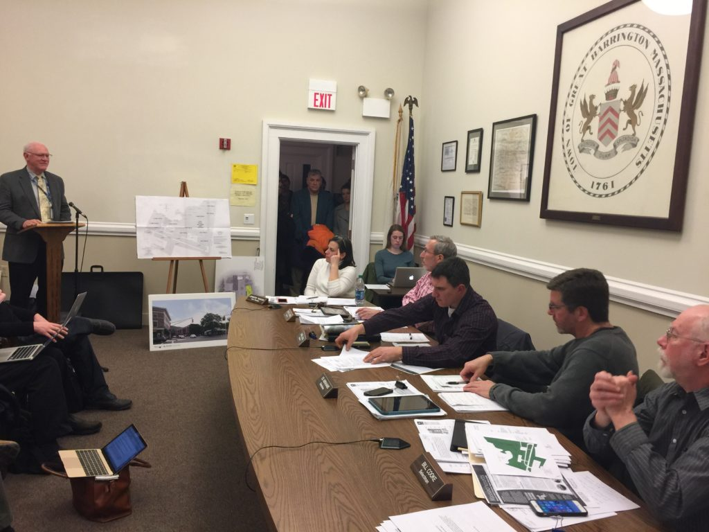 Airport general manager Ken Krentza speaks to the Selectboard. At the table, from left, Town Manager Jennifer Tabakin, board members Steve Bannon, Dan Bailly, Ed Abrahams and Bill Cooke. Photo: Heather Bellow