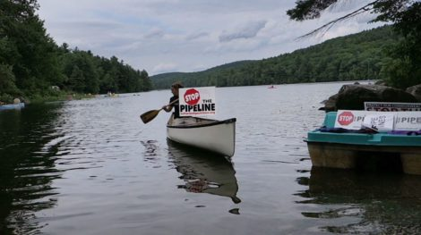 Last summer pipeline protestors took to canoes on Lower Spectacle Pond in Otis whose waters will be drained to flush out the pipeline. Photo: Ben Hillman
