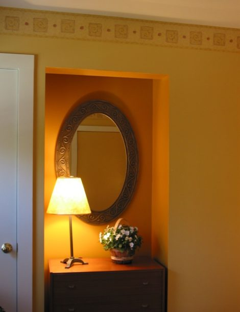 """Here is an alcove in a bedroom at the former Silo B&B in North Egremont. A deeper shade of gold was used in the recesses to create interest. Trim: """"Cameo White""""; walls: """"Amber Waves""""; accented alcoves, """"Peanut Butter"""". In the adjoining bath, the same colors were used in an opposite way with the deeper color for the main walls and the lighter for accents."""