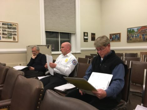 From left, Building Inspector Ed May, Fire Chief Charles Burger, and Police Chief William Walsh preparing to explain their departments' budgets to a combined meeting of the Selectboard and Finance Committee. Photo: David Scribner