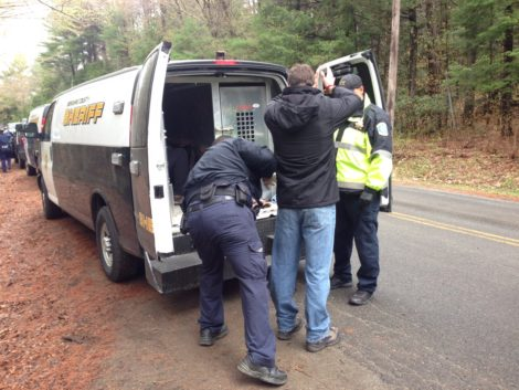 A protester being put into a Berkshire County Sheriff's van. Photo: Will Elwell