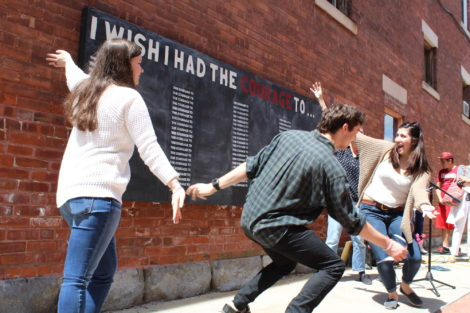 YOB Intern Bethany Rhoades and members Mason Amann Howison, Rachel Bozza celebrate the unveiling of the wall. Photo: Terry Cowgill