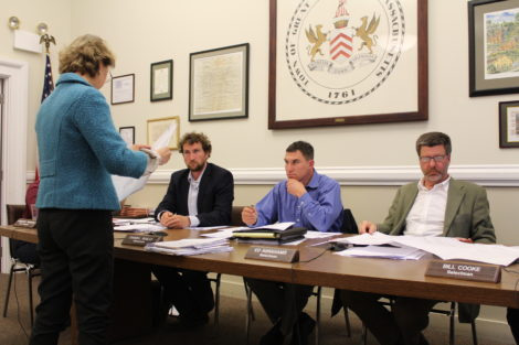Airport attorney Lori Robbins presents materials to the Selectboard. Photo: Terry Cowgill