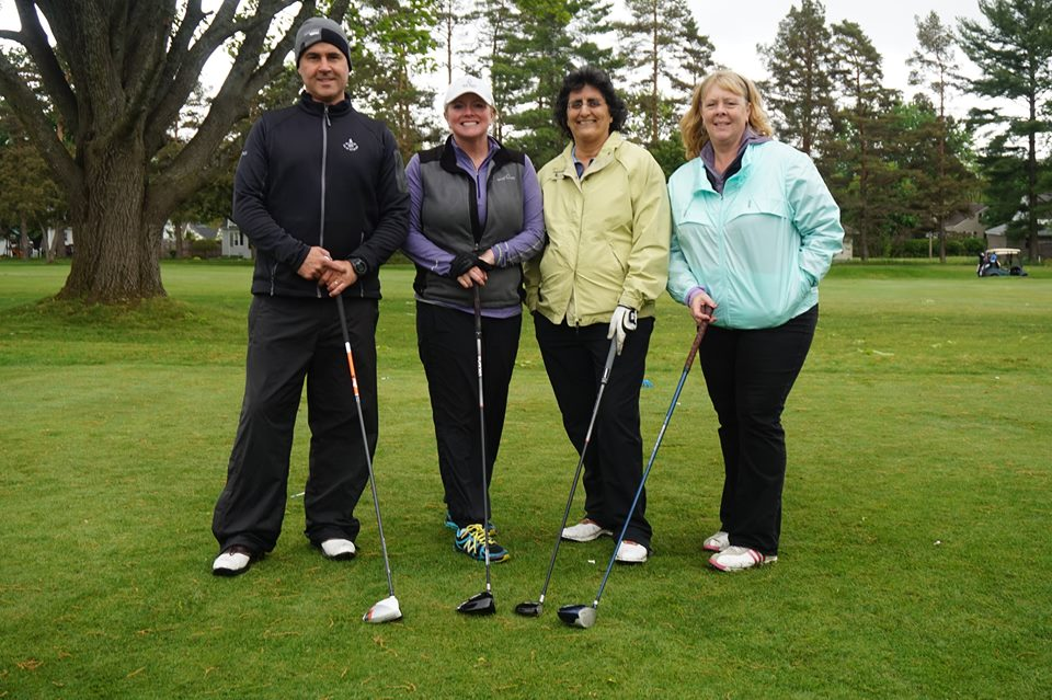 The team of James Pollard, Katie Phillips, Barb Hassan and Wendy Goodwin at Berkshire County Arc's 23rd annual gold classic.