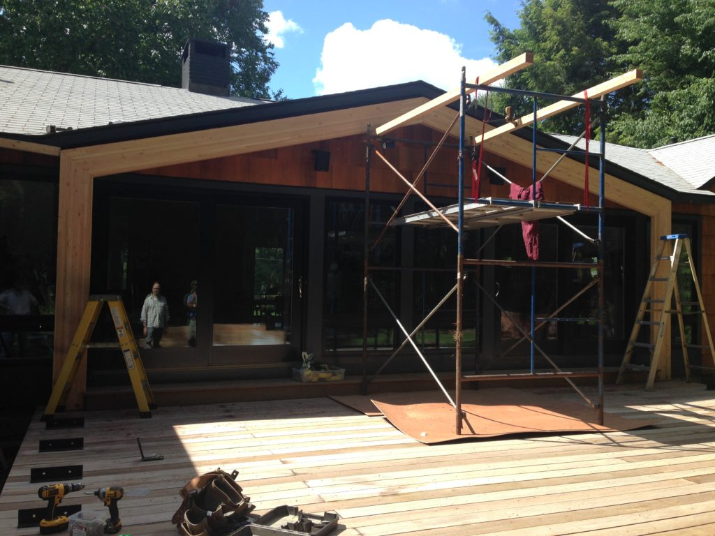 Aligning screen porch structure with existing roof lines and building upon the previously constructed reinforced deck. - Photo: Michael Alper