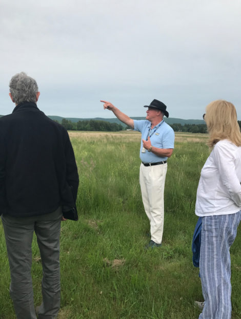 Airport operations manager Kenneth Krentsa points to the location of the new hangars during a tour of the airport property. Photo: Victor Feldman