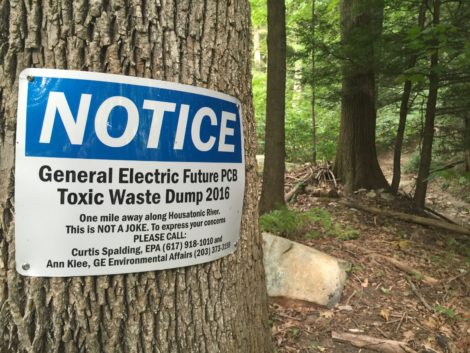 A sign tacked to a tree in the woods bordering Rising Pond in Housatonic, Mass., where GE would bury PCB sludge.