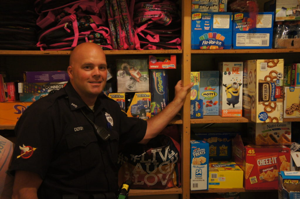 Officer Derby has a collection of snacks in the basement of the Pittsfield Police Department that he hands out to neighborhood children.
