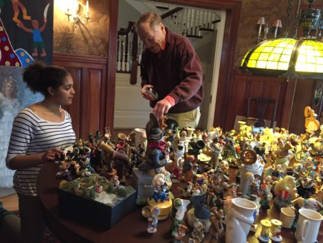 Sorting through Eli's collection of tuba-player statuettes. Photo: Carolyn Newberger