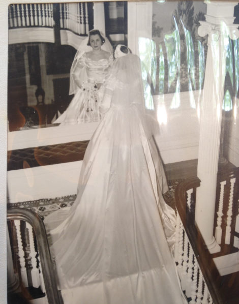 Connie as a bride on the staircase.