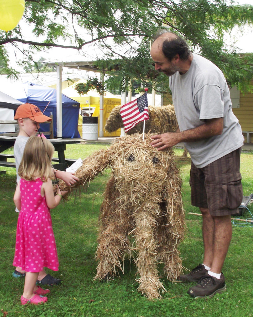 Mike DiMisa, right, shows young fairgoers how to build an elephant out of straw. Photo courtesy Columbia County Fair