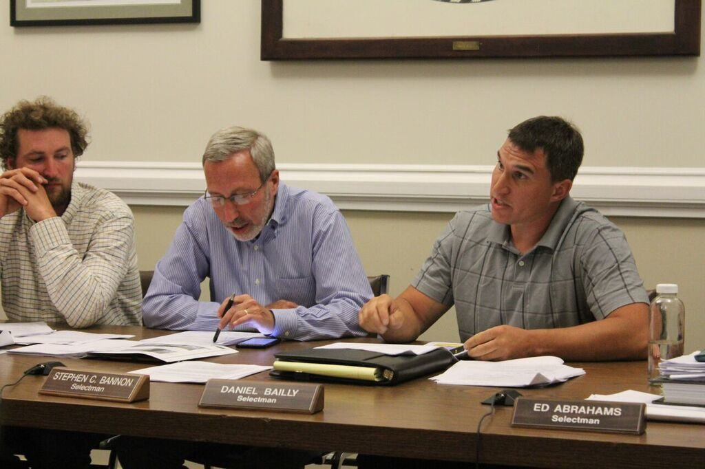 Selectman Dan Bailly suggests there could be other reasons for lead levels detected by airport neighbors. At left are selectmen Sean Stanton and Steve Bannon. Photo: Terry Cowgill