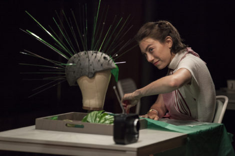 Madeline Wise as Joan, creating a headdress. Photo: Maria Baranova