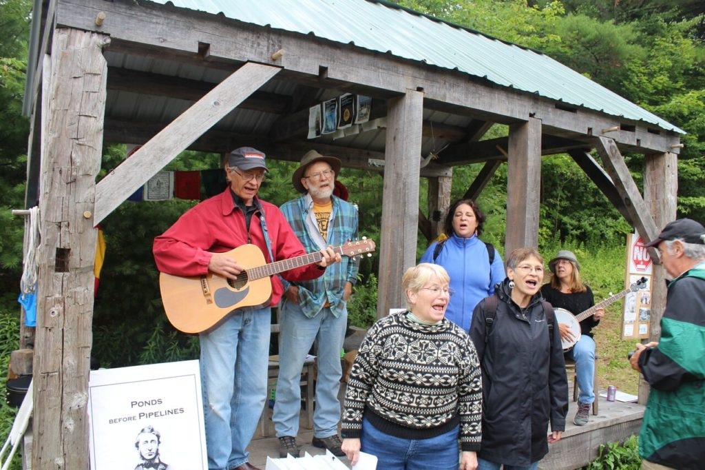 """Led by Graham Dean on guitar, the Hoping Machine singers perform """"If I Had a Hammer."""" Photo: Terry Cowgill"""