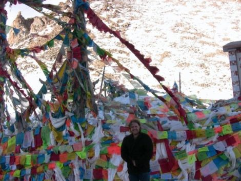 Wallman amidst Buddhist prayer flags.