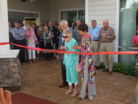 Joe Toole helps his mother cut the ribbon on the Marriott Courtyard. Photo: Terry Cowgill