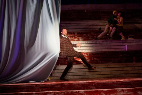 Professor Harold Hill (Robert Johanson) closes the curtain on act one of THE MUSIC MAN. Photo: