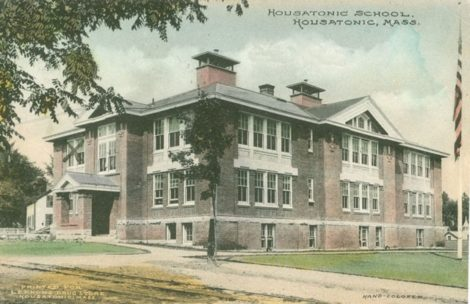 A historic representation of the Housatonic Elementary School, as depicted in a colorized postcard, printed for Lennons Drug Store in Housatonic.