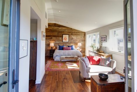 CAPTION: Bedroom -GB, MA Cozy Berkshire Bedroom with reclaimed wood wall, sitting area and fireplace for those cool nights. Photo: Jess Cooney
