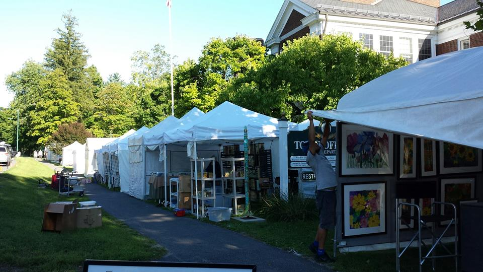 Artisans prepare for the 2016 Stockbridge Summer Arts and Crafts Show. Photo courtesy Stockbridge Chamber of Commerce