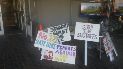 Protest signs in the hallway outside the BCC auditorium where the hearing on electric rates was going on. Photo: Dana Drugmand