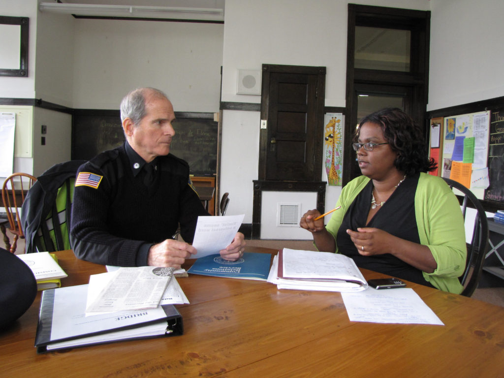 Gwen VanSant has worked with various town agencies to encourage multicultural training. She's shown here with former Stockbridge Police Chief Rick Wilcox in 2015. Photo: David Scribner