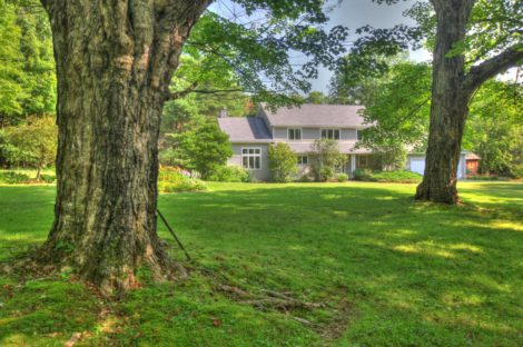 A Perfect Country Home with Acreage, Pond, Barn and Protected Land on Three Sides!