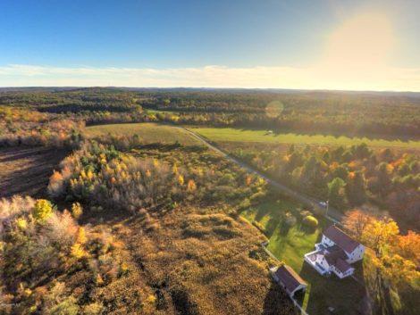 Spectacular vistas, astounding acreage, and a classic New England farmhouse, all on 560 acres
