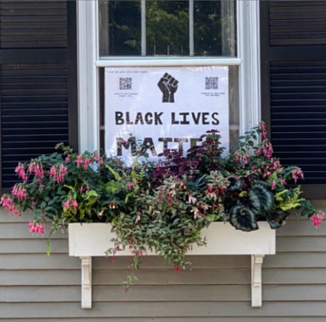 Window box with Black Lives Matter sign