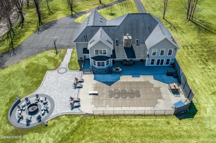 An aerial shot of 62 Blythewood Drive, Pittsfield, showing the pool and outdoor terrace