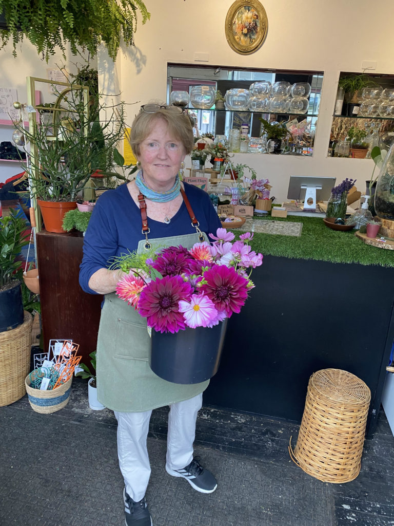 Bonnie Marks, owner, with flowers at The Plant Connector in North Adams